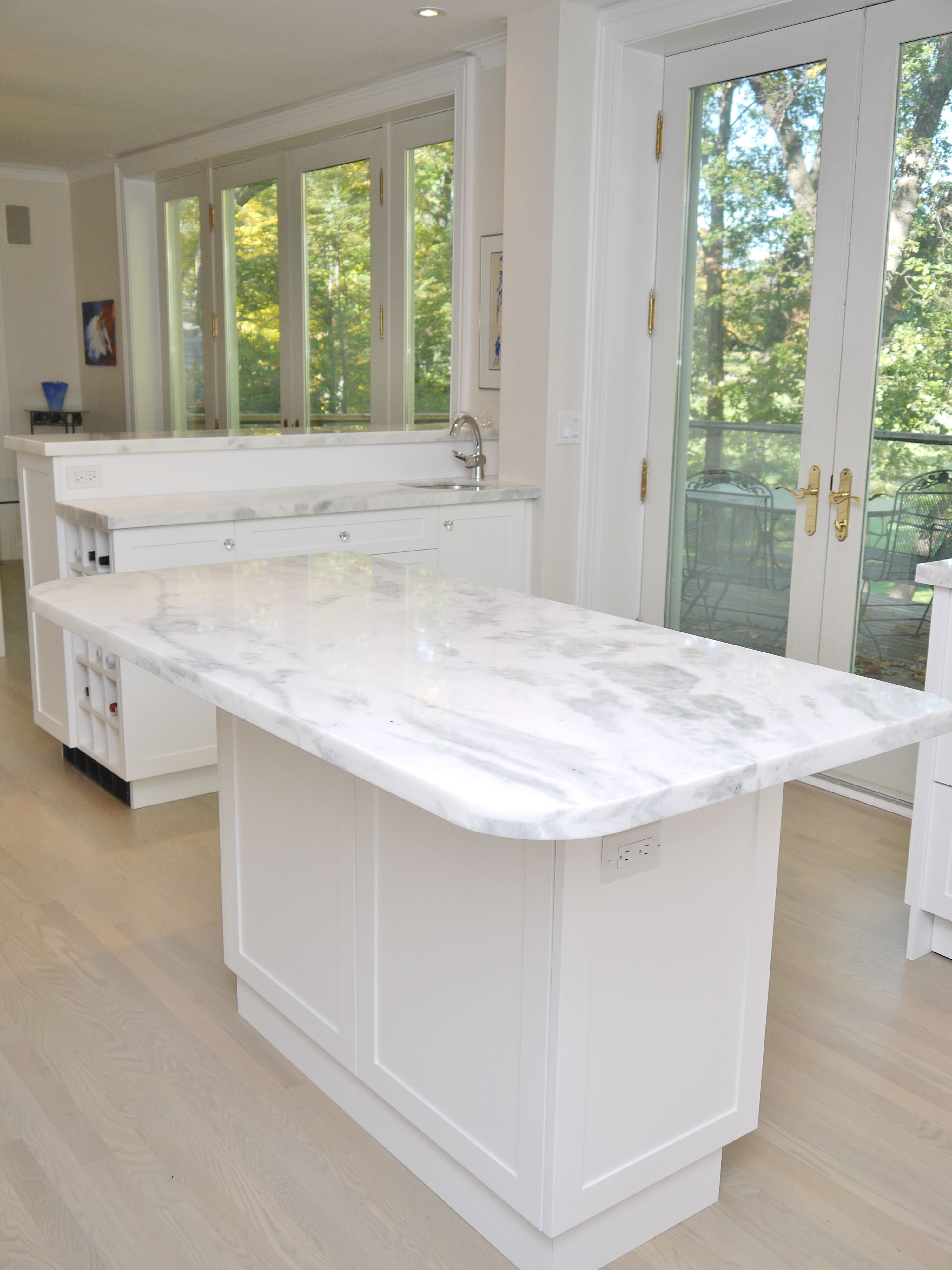 Island With Seating Space Complete With Mont Blanc Quartzite Countertops.  #kitchendesign #interiordesign