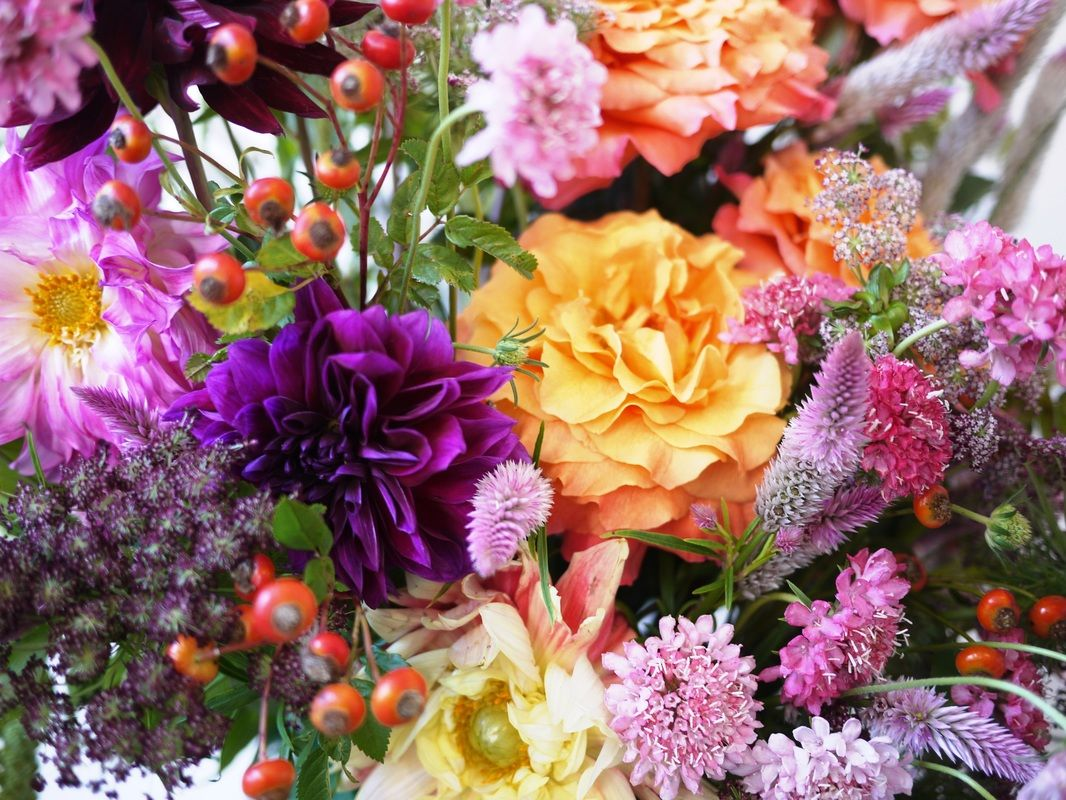 Detail fall flower arrangement with roses rose hips dahlias detail fall flower arrangement with roses rose hips dahlias grovedesign izmirmasajfo