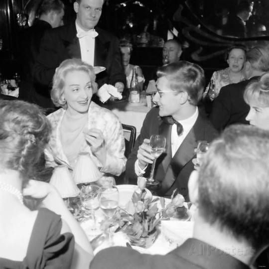 Marlene Dietrich and Yves Saint Laurent at a restaurant in Paris 1959