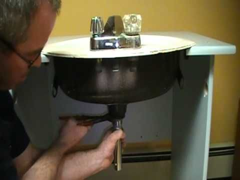 Photo Album Website Old plumber shows how to install a drain on a bathroom sink basin