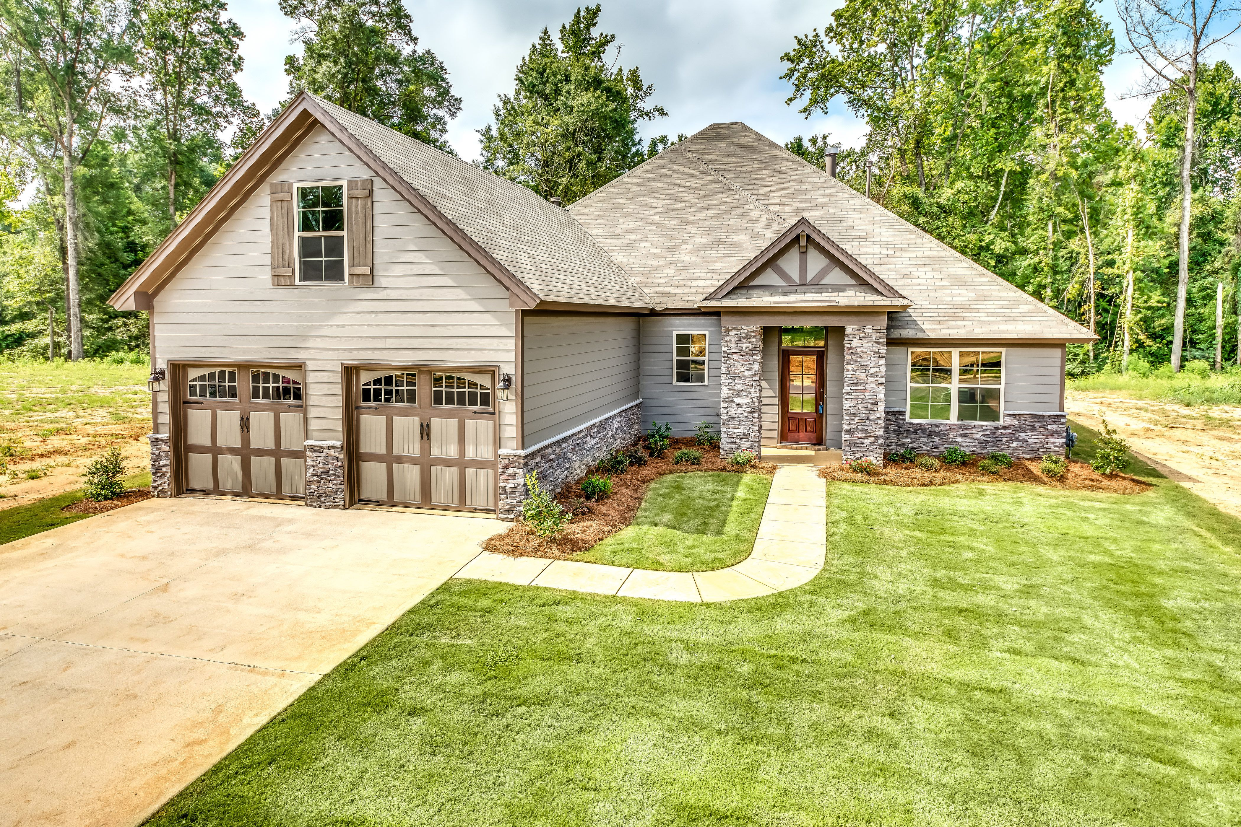 Gorgeous House With Light Grey Siding And Brick Exterior To Serve As An Accent Along With The Brown Wood Paneled Shutters Light Brick Exterior Brick New Homes