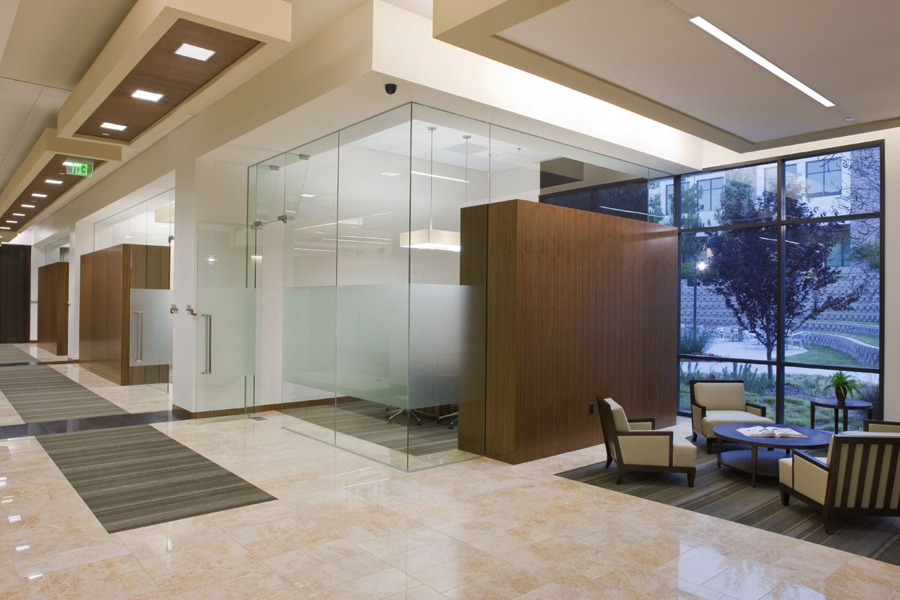 small conference room  remove walls and add laminated glass with semi