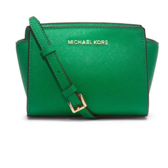 """Michael Kors Selma Mini Saffiano Leather Crossbody Great condition! Tiny mark on inside of the bag and slight scratches on hardware (last photo). Style comes naturally to the Selma mini; offering up a streamlined shape and subtle logo detailing, it strikes a high-style chord, while the scaled-down silhouette promises a smart style choice for transitioning from day to night. 100% authentic. 5 1/2"""" H x 8 1/2"""" W x 3"""" D. No trades, please don't ask.   ⭐️Feel free to ask any reasonable questions…"""