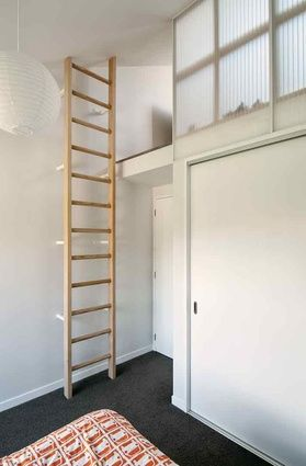 a ladder leads to a mezzanine space in both the bedrooms