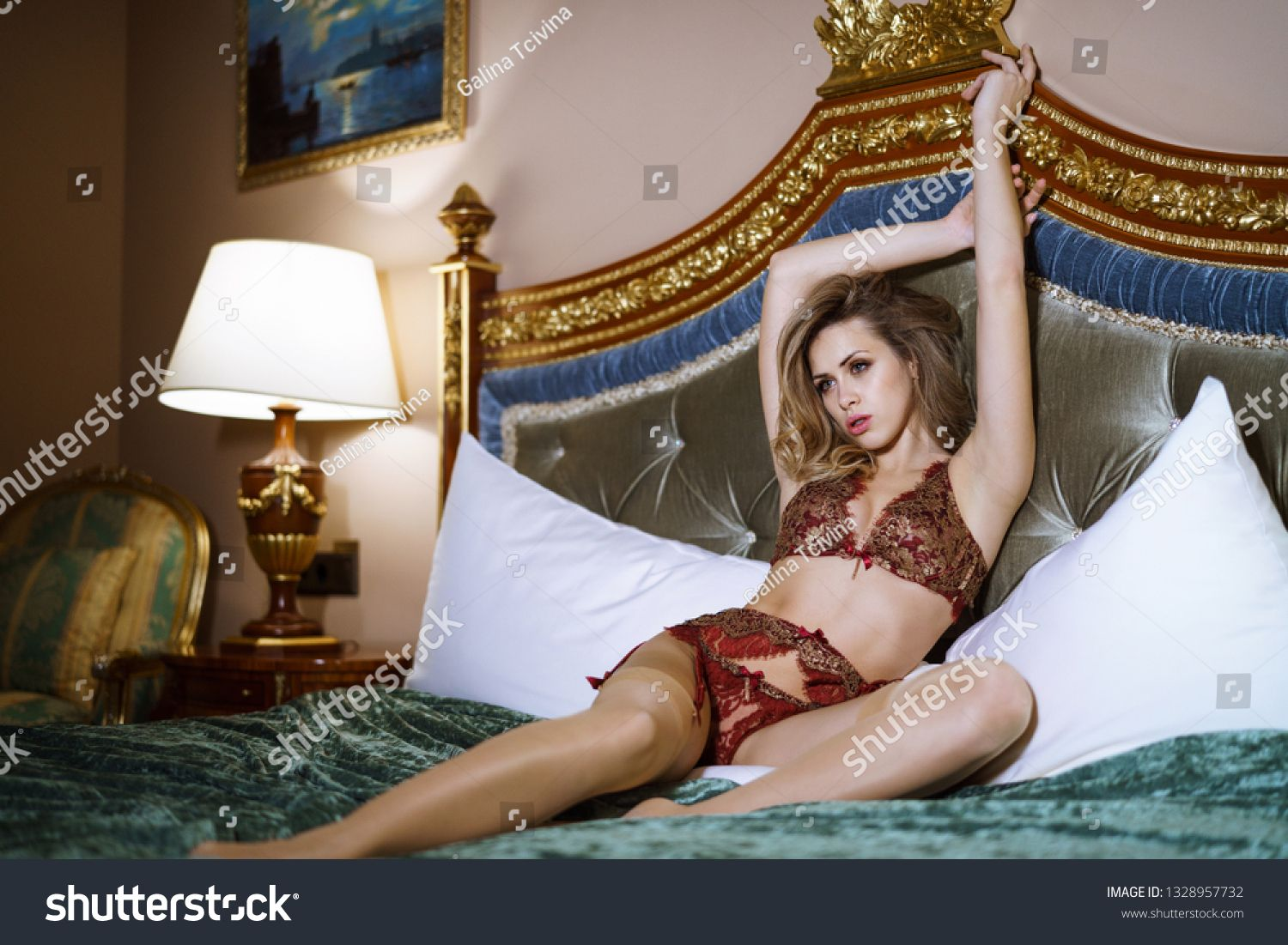 Beautiful sexy lady in red panties and bra on the bed. Close up fashion portrait of model indoors. Beauty blonde woman. Attractive female body in lace lingerie. Closeup fashionable naked girl #Sponsored , #affiliate, #fashion#Close#bed#indoors
