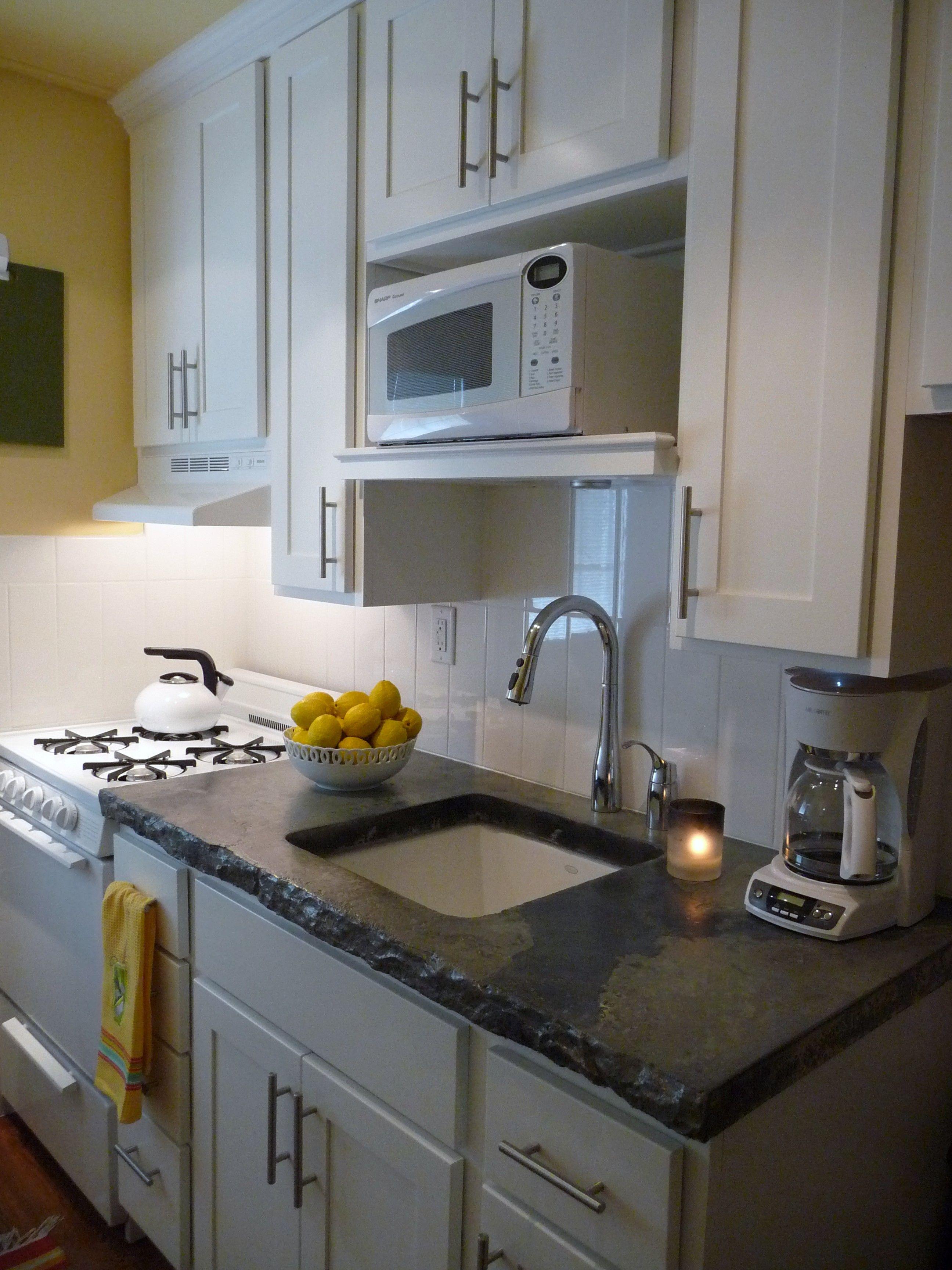Kitchen remodel concrete sink galley kitchen track lighting