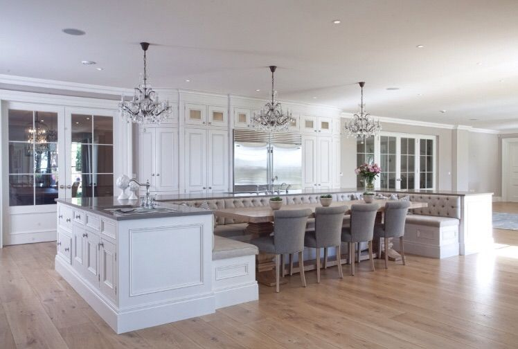 integrated eating in the island with grey washed oak table