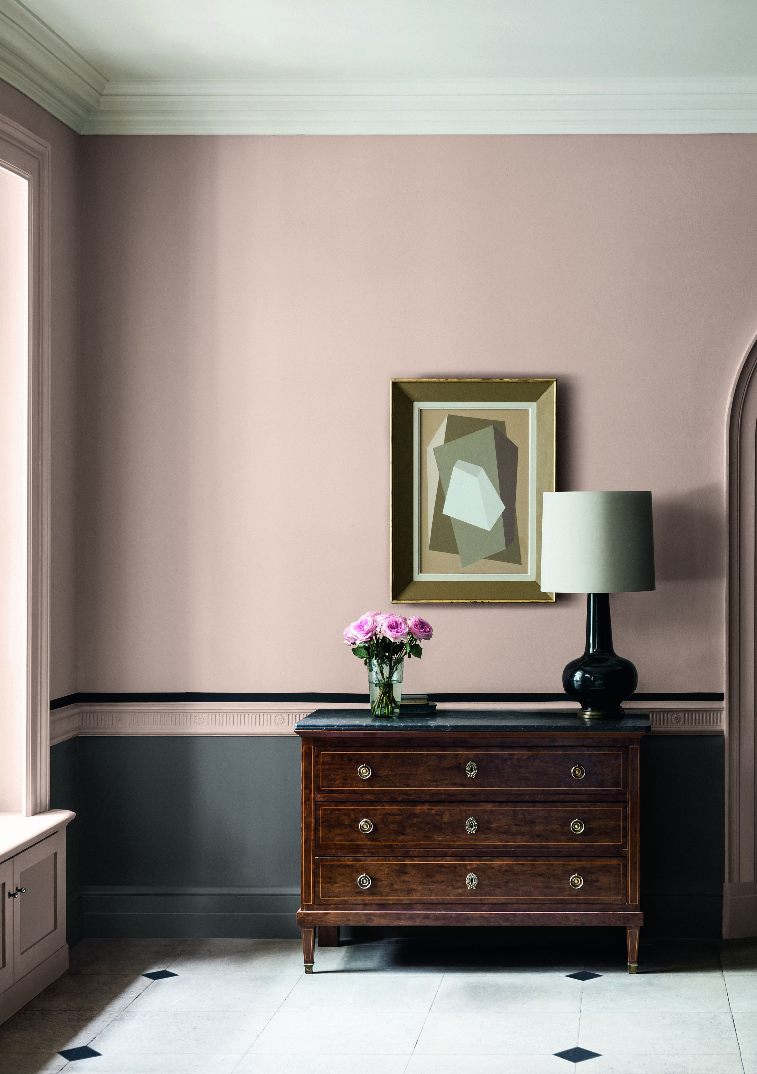 Combining a grey pink paint with black creates an effortlessly smart finish here and picks out the black of the floor tiles and lamp base neatly tying the