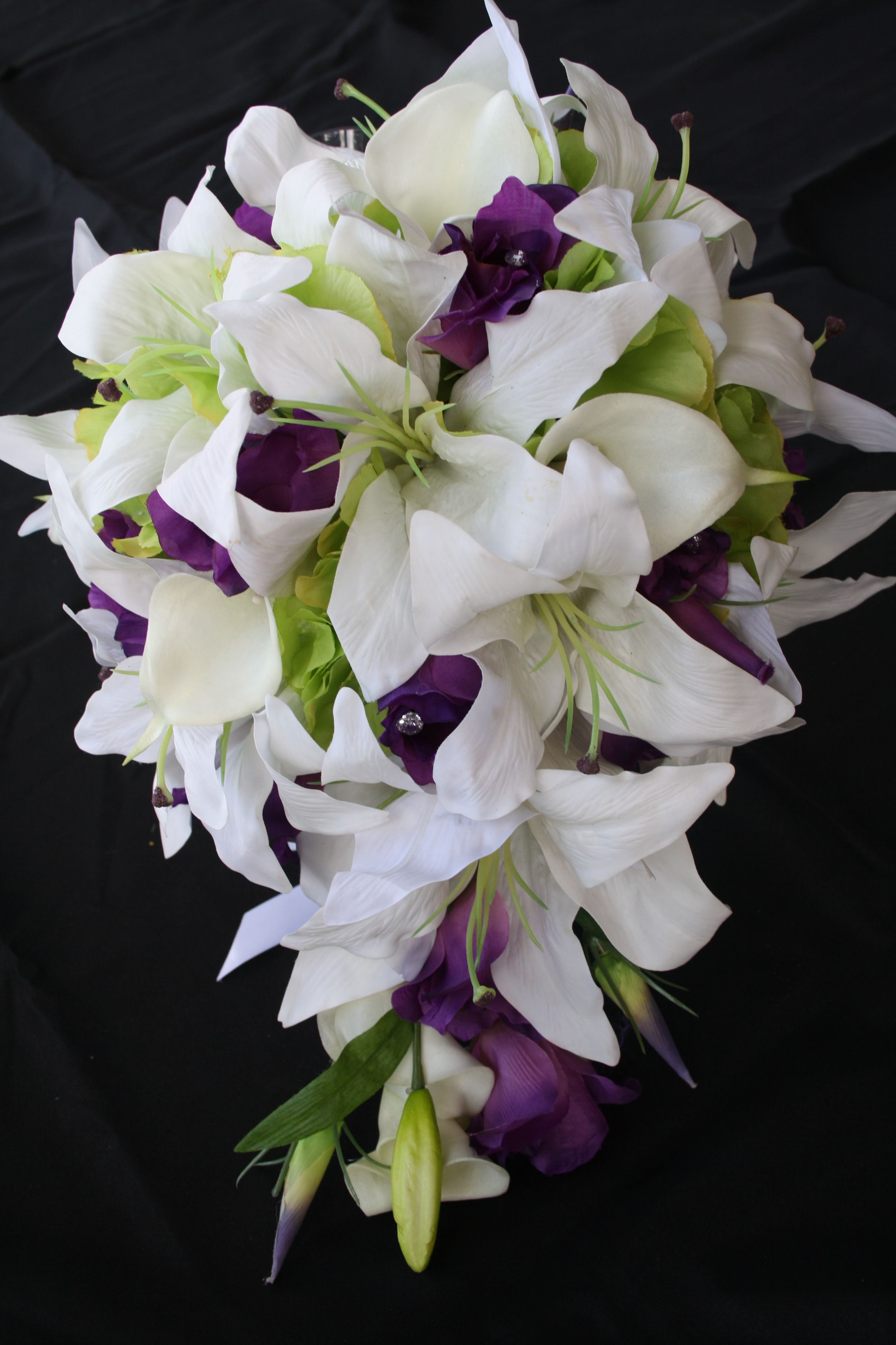 Teardrop bouquet of White Lillies, Purple Lisianthus, White Calla Lillies, Green Hydrangea and crystals