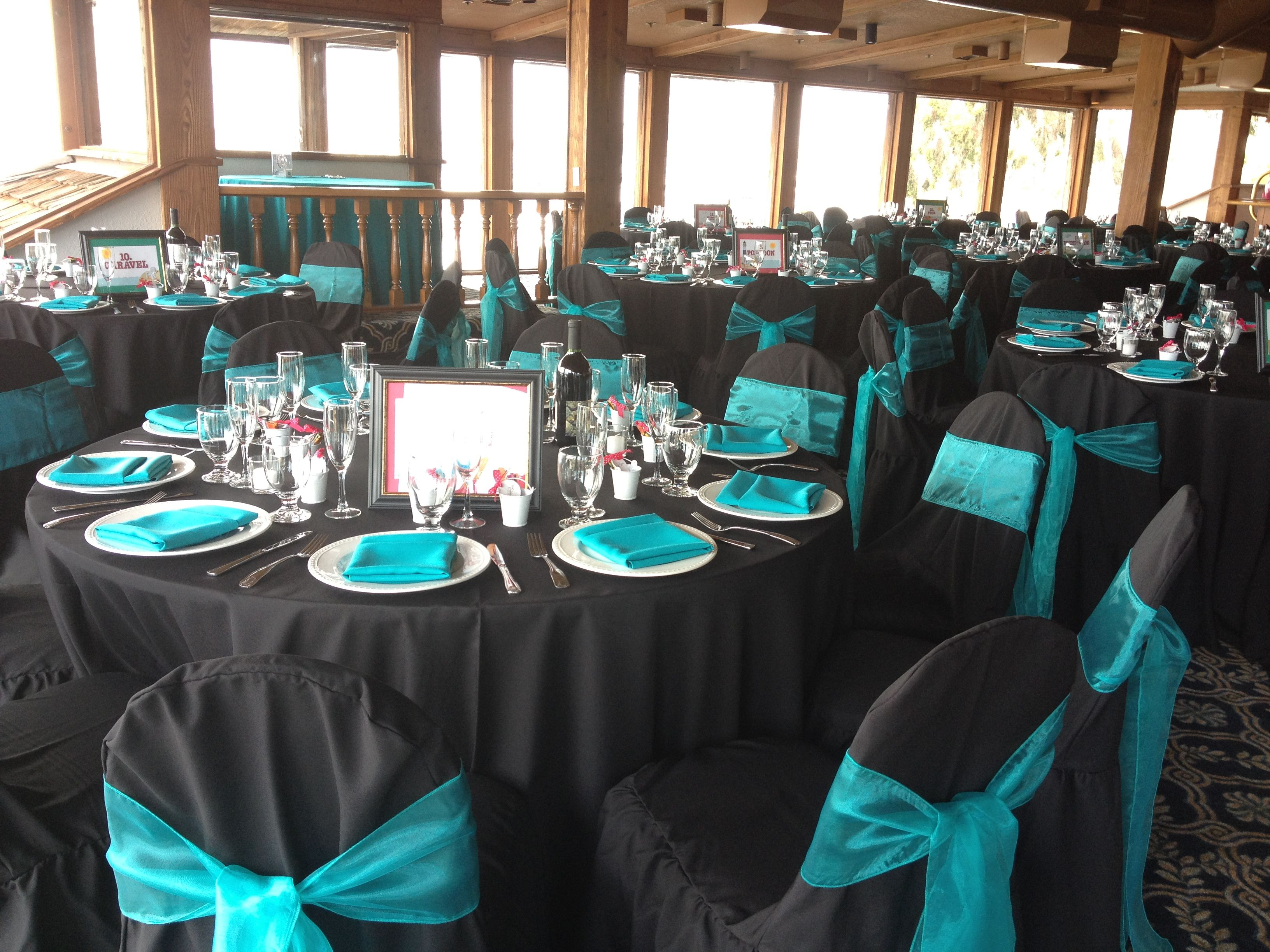 Marina Village Venue Black Linens with Turquoise Napkins along
