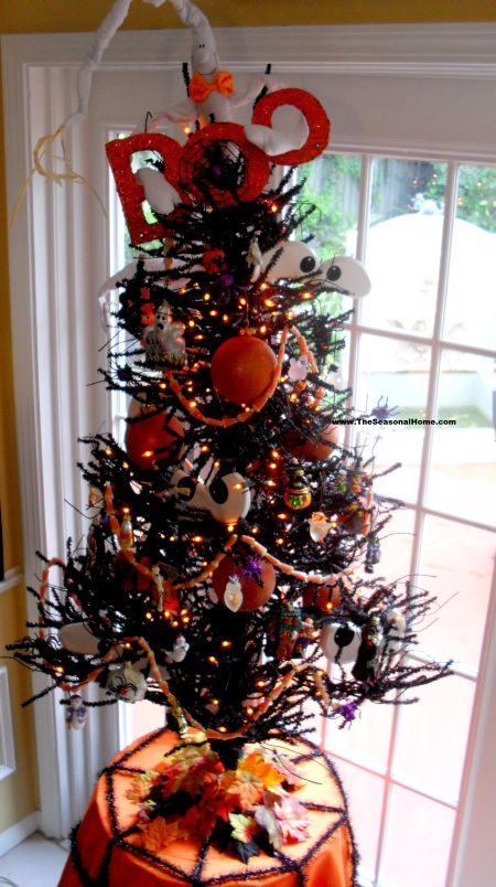decorated halloween tree from garland to the big boo on top see