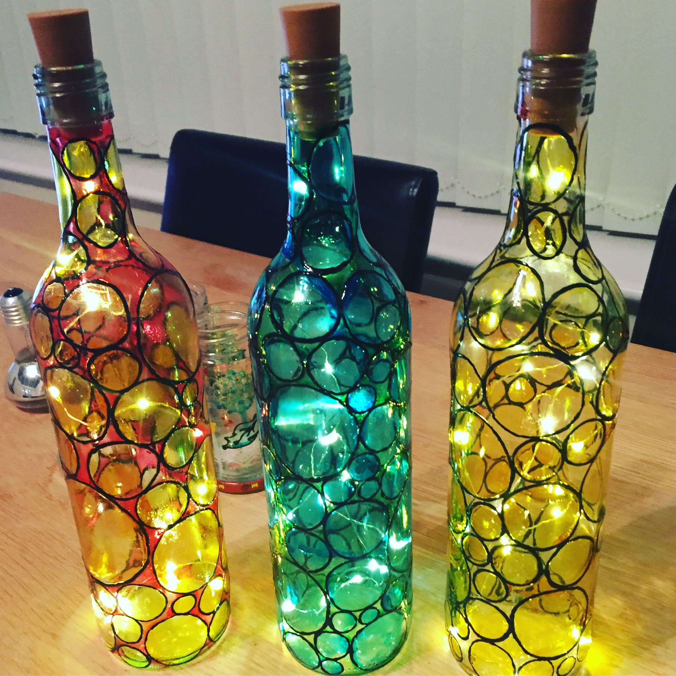 Glass painted wine vases with cork fairy lights