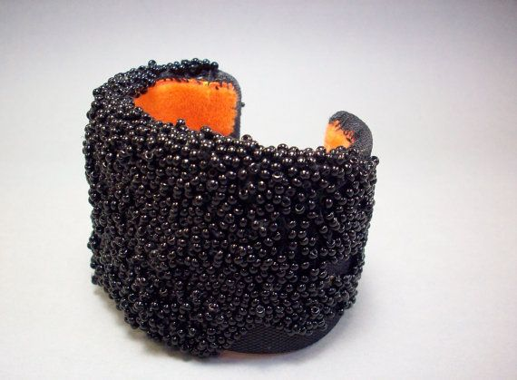 Caviar Bracelet cuff Hand sewn and embroidered with hundreds of tiny glass beads and lined with orange velvet caviar Bracelet cuff