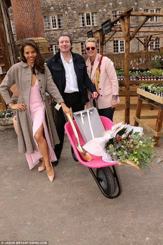 Lady And Lord Weymouth Monty Saul Pose With A Bunch Of Flowers In Wheelbarrow