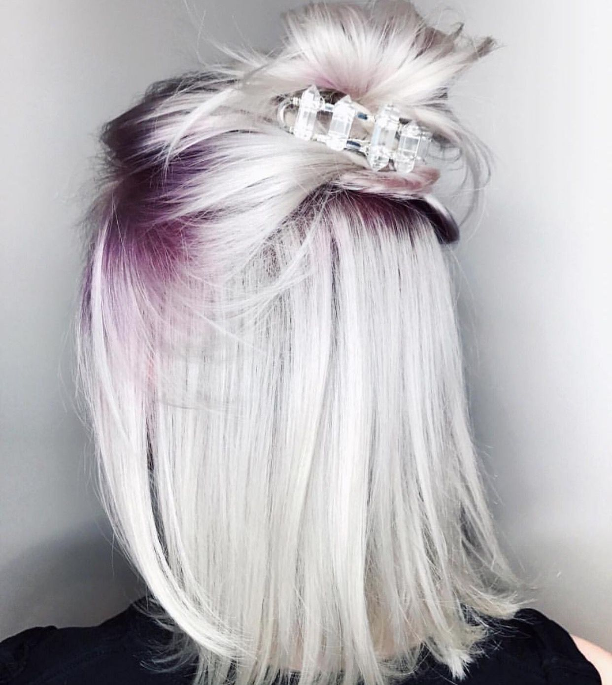 Icy platinum blonde hair with purple roots Short hair in
