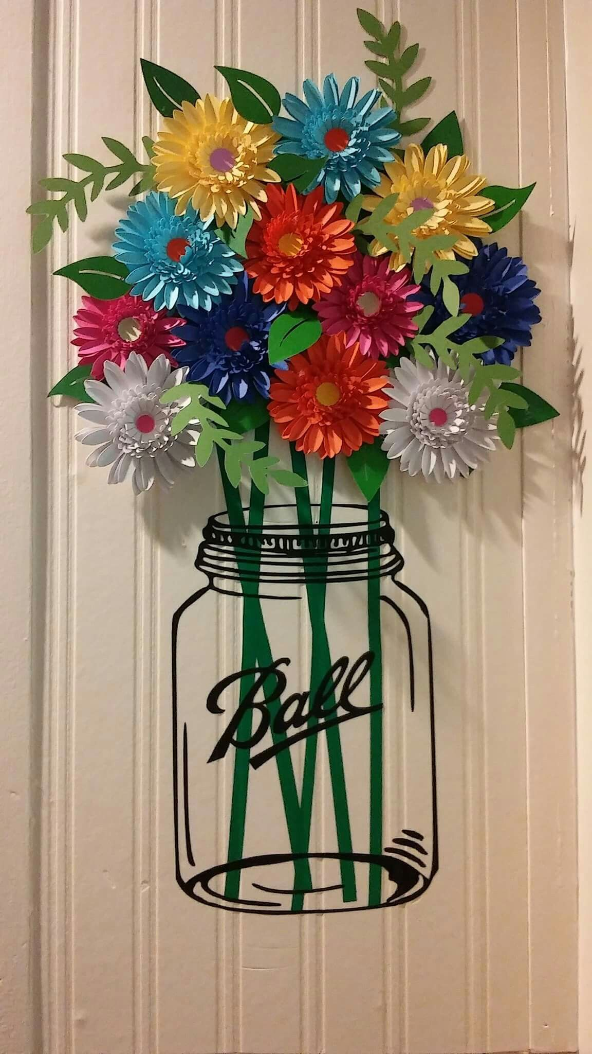 Mason jar flowers out of paper and vinyl stems and jar