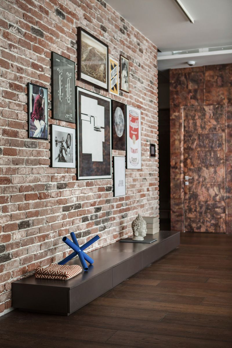 a brick feature wall with photo art. | interior design | pinterest