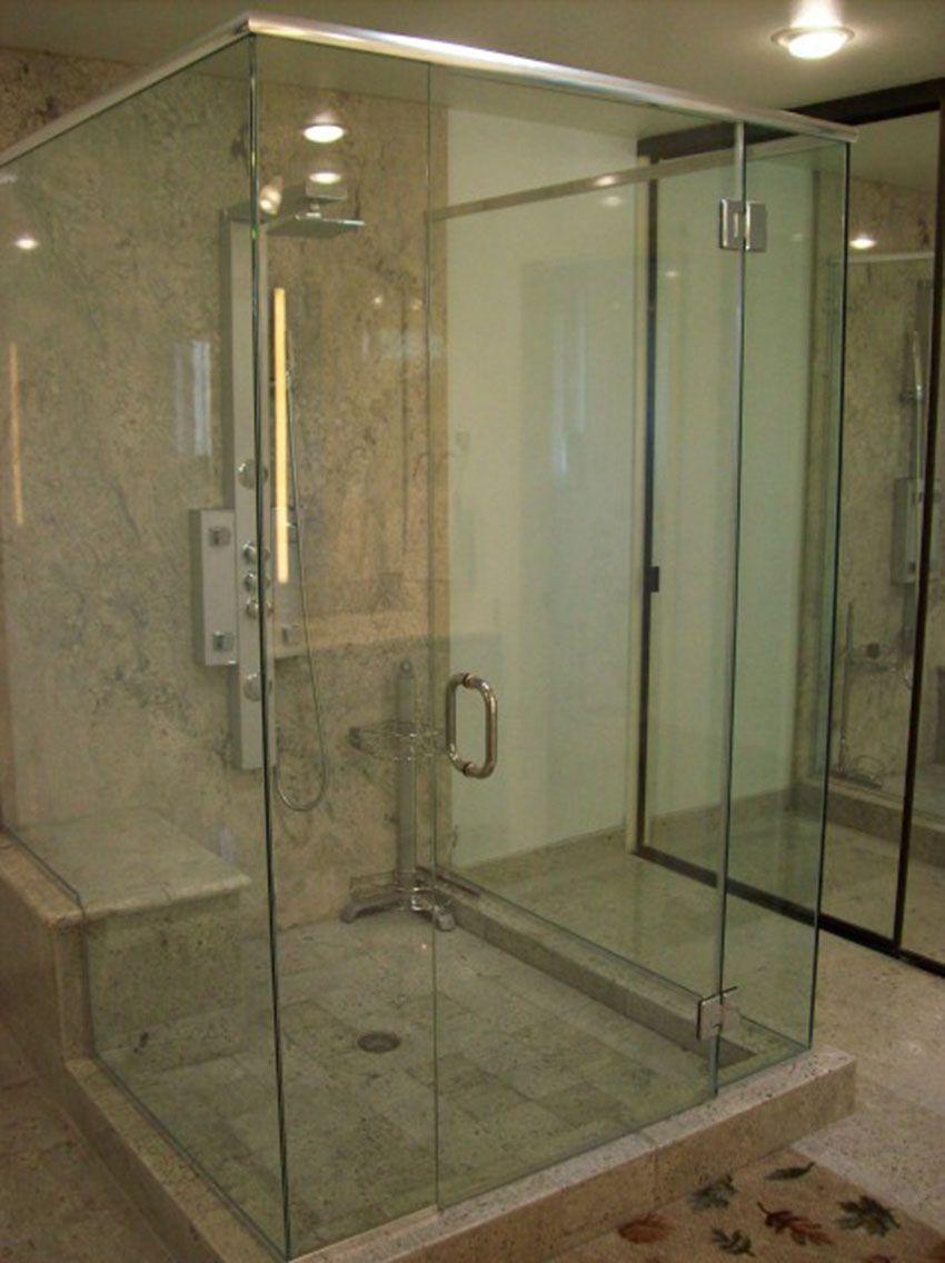 Frameless Shower Door In A Glass Box Design With A Corner Bench