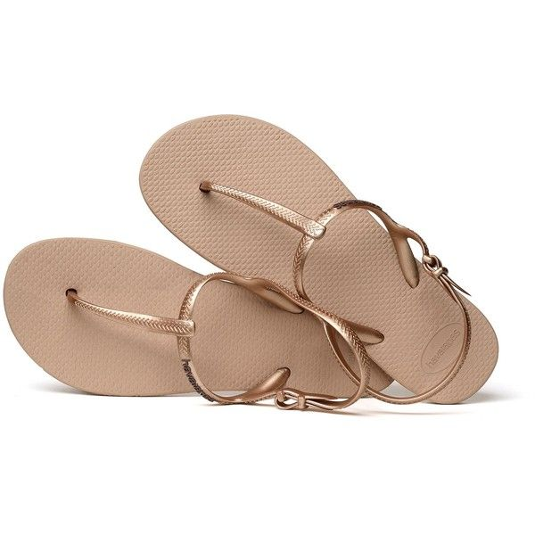 Havaianas Sandals Havaianas Thong Sandals In Rose Gold - Freedom Rose... (¥3,370) ❤ liked on Polyvore featuring shoes, sandals, toe thong sandals, rose gold shoes, flat thong sandals, thong sandals and havaianas sandals