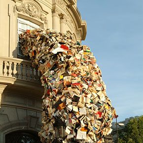 Spanish artist Alicia Martin used thousands of old books to create amazing book waterfalls that pour out the windows and straight into the streets. She is well known for her massive book installations across Europe, however Martin's most recent series, called Biografies, are based in her hometown, Madrid.
