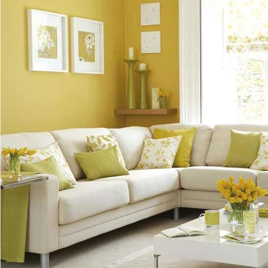 Yellow green walls and white living room sectional