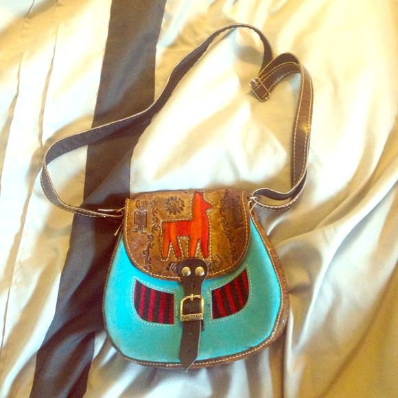 Original leather mini purse handmade in Peru. 2 colors left. Original  leather. Unique designs, there are not 2 of the same. Handmade by Peruvian artisans. Each 45 Bags
