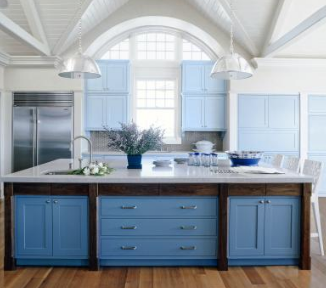 In This Kitchen Design These Shades Of Blue Work To Ground The High Ceilinged Space And Tie Tog Kitchen Cabinet Trends Kitchen Cabinets Kitchen Cabinet Colors