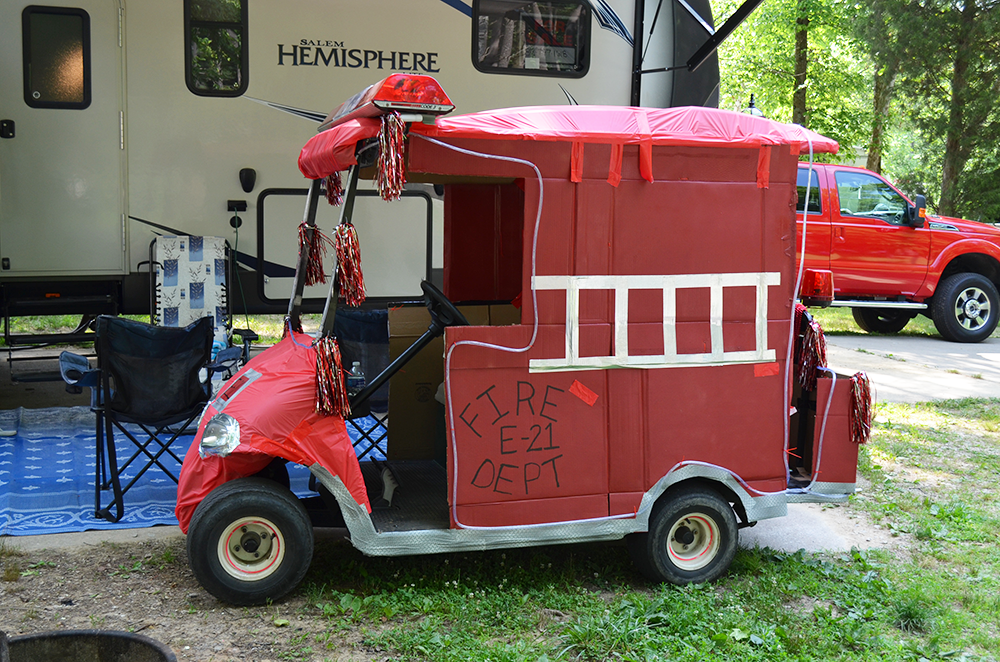 Fire Department themed golf car decorations at Lake Rudolph Campground & RV Resort.