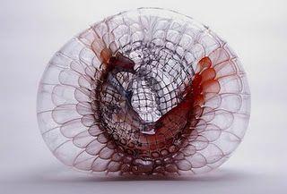 glass pieces blown in a metal wire mesh are by German artist Jorg Zimmermann