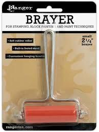 Ranger brayer . Use this brayer with the Shadow Press Station to add an inked drop shadow effect to any of Tim Holtz debossing folders.