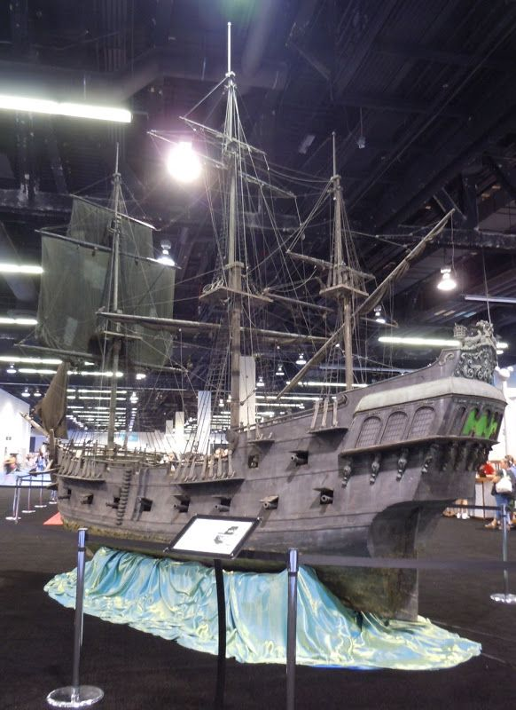 Hollywood Movie Costumes and Props: Black Pearl miniature ship from Pirates of the Caribbean... Original film costumes and props on display