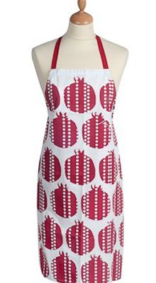 This luxurious apron with its modern take on pomegranates was designed by Barbara Shaw. This hand screen printed apron is durable, washable, made of 100% sturdy cotton drill canvas, and adorned with funky pink and burgundy shades. Pomegranates are a symbol of fertility and abundance making this apron well suited for any modern chef's kitchen.