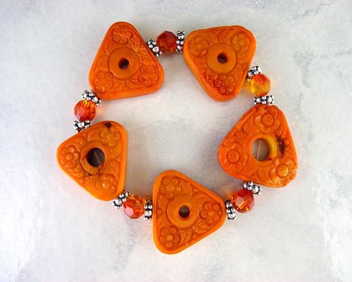 Floral Carved Orange Coral Triangle Stretch Bracelet $33.50