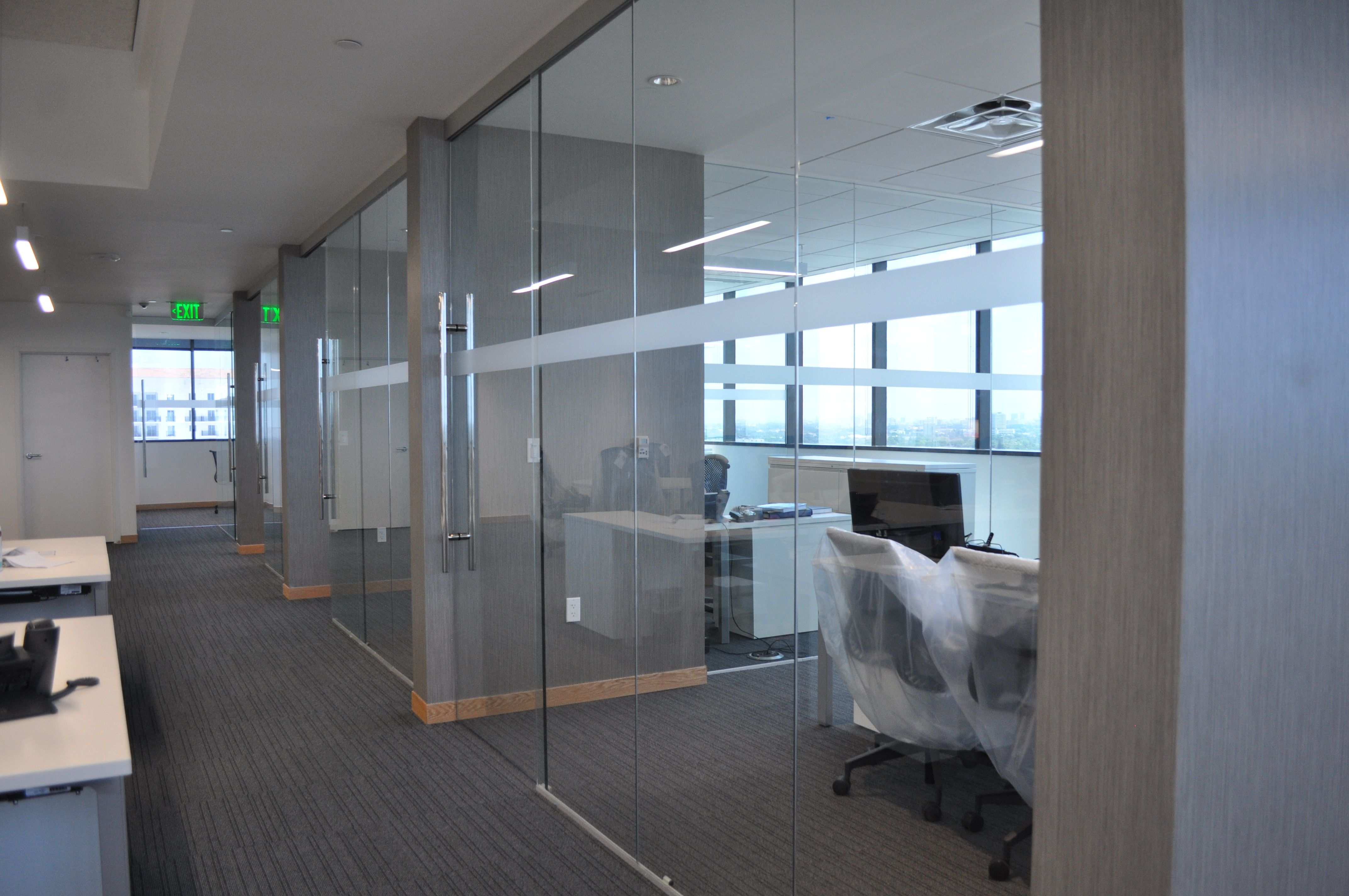 Frameless glass office fronts with walls protruding nfcu Office partition walls with doors