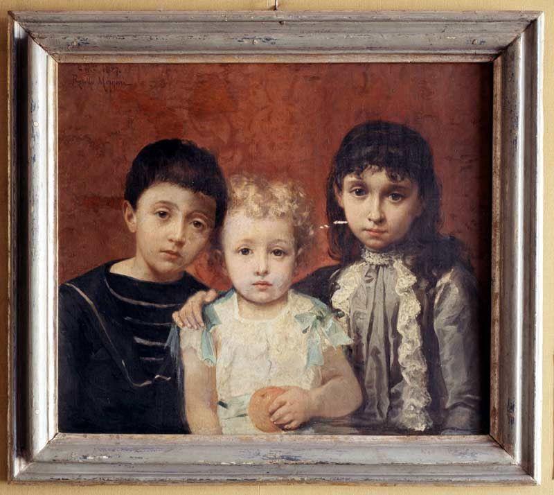 Guido tra la sorella Erina e uno dei due fratelli morti in tenera età.