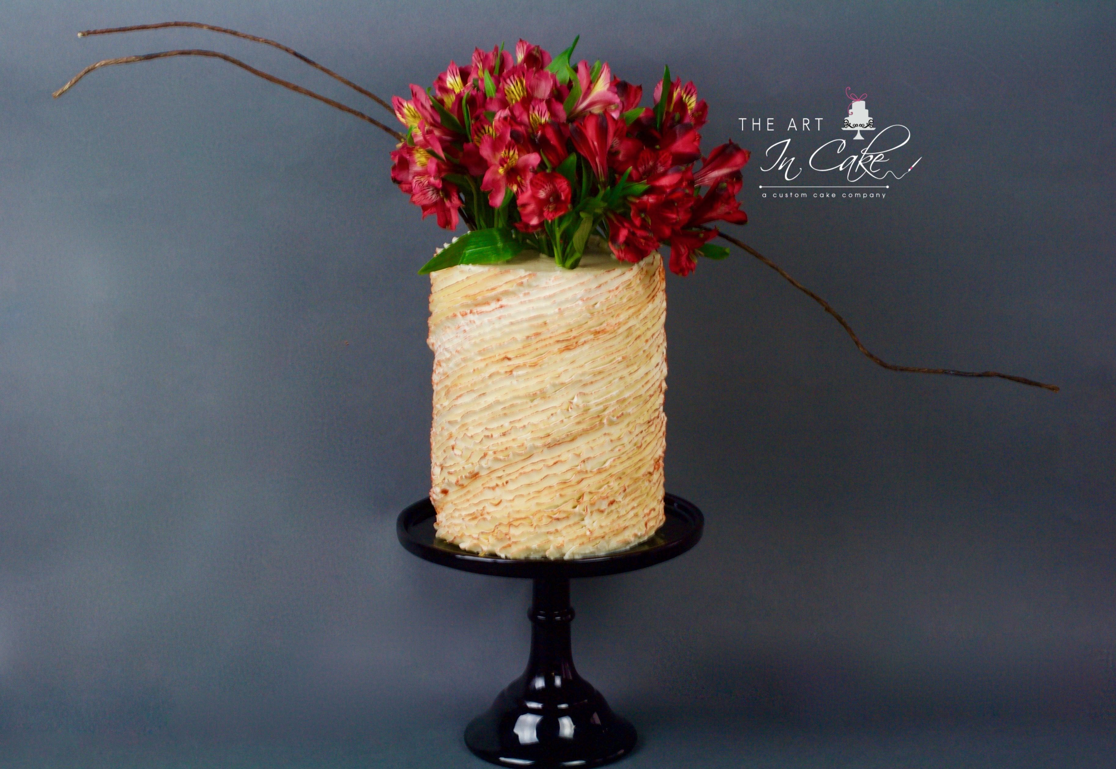 My wrap around diagonal ruffle cake painted with metallic