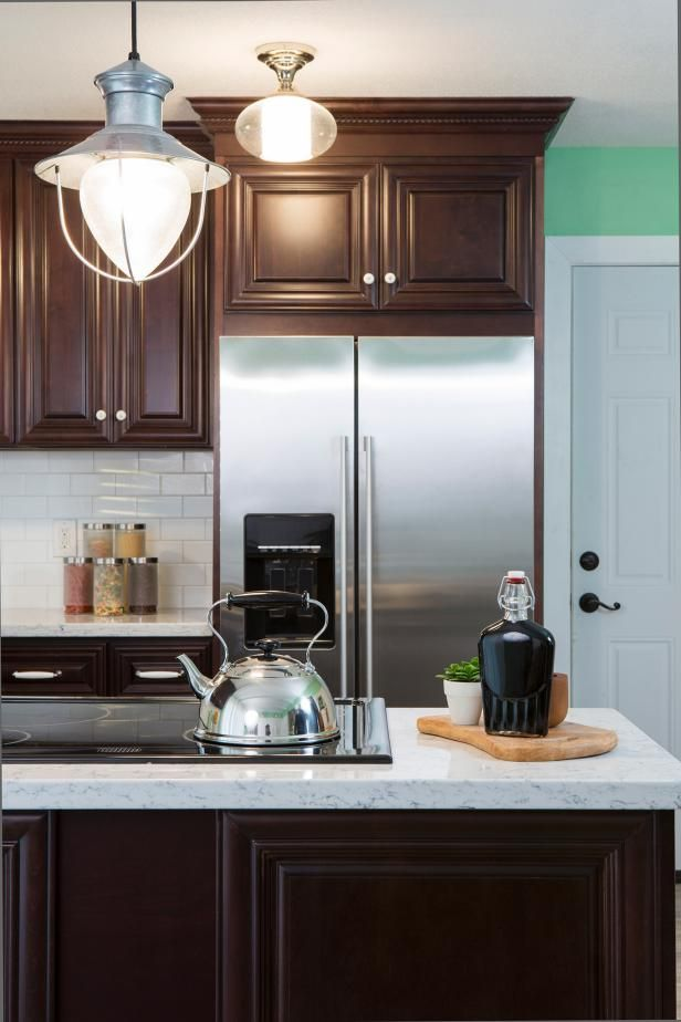 HGTV s Renovation Raiders create a modern country kitchen with stainless  steel appliances dark cabinetry