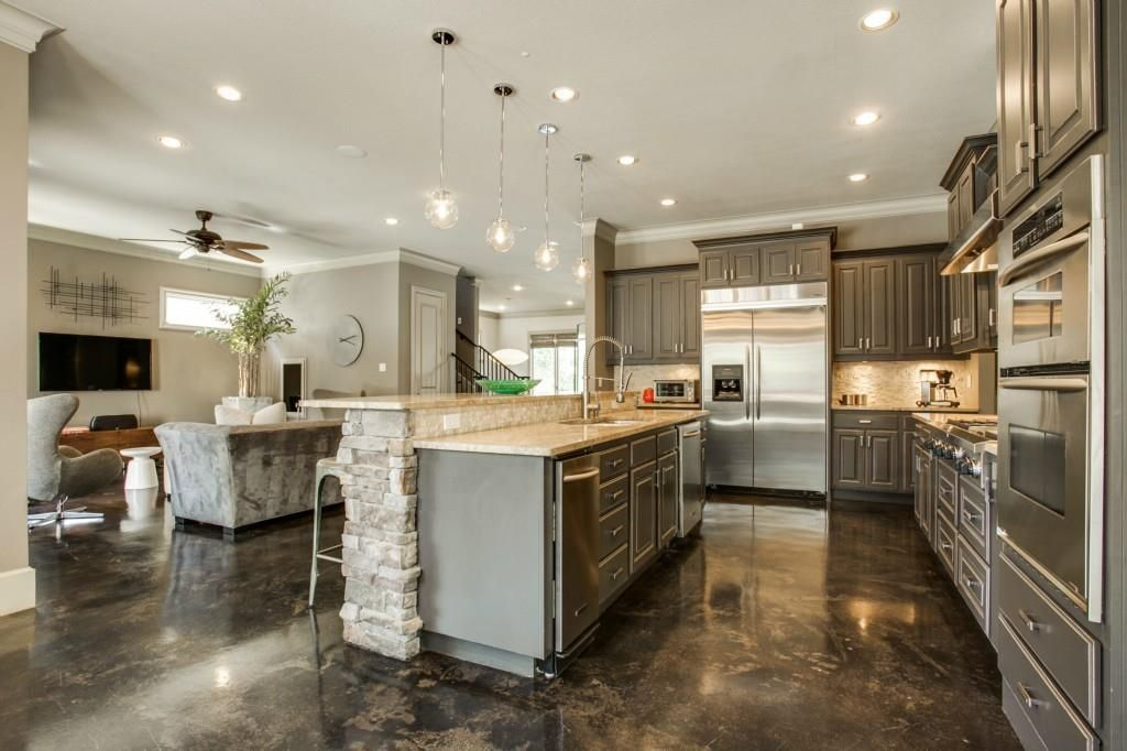 Traditional Kitchen with L-shaped, Limestone Tile, Acid Stained ...