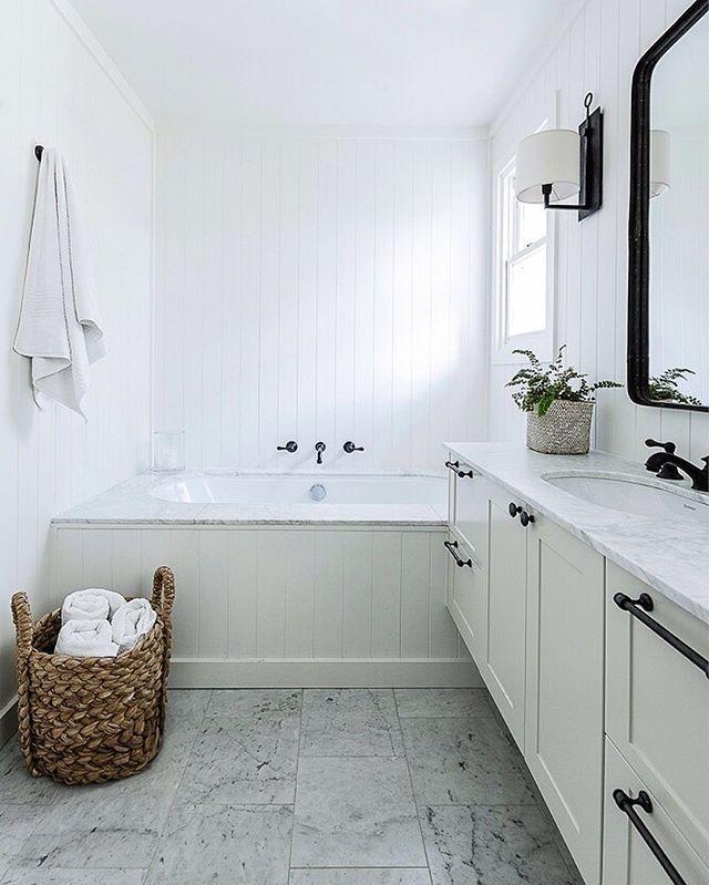 Modern Farmhouse Bathroom black, white, and marble in this modern farmhouse bathroom