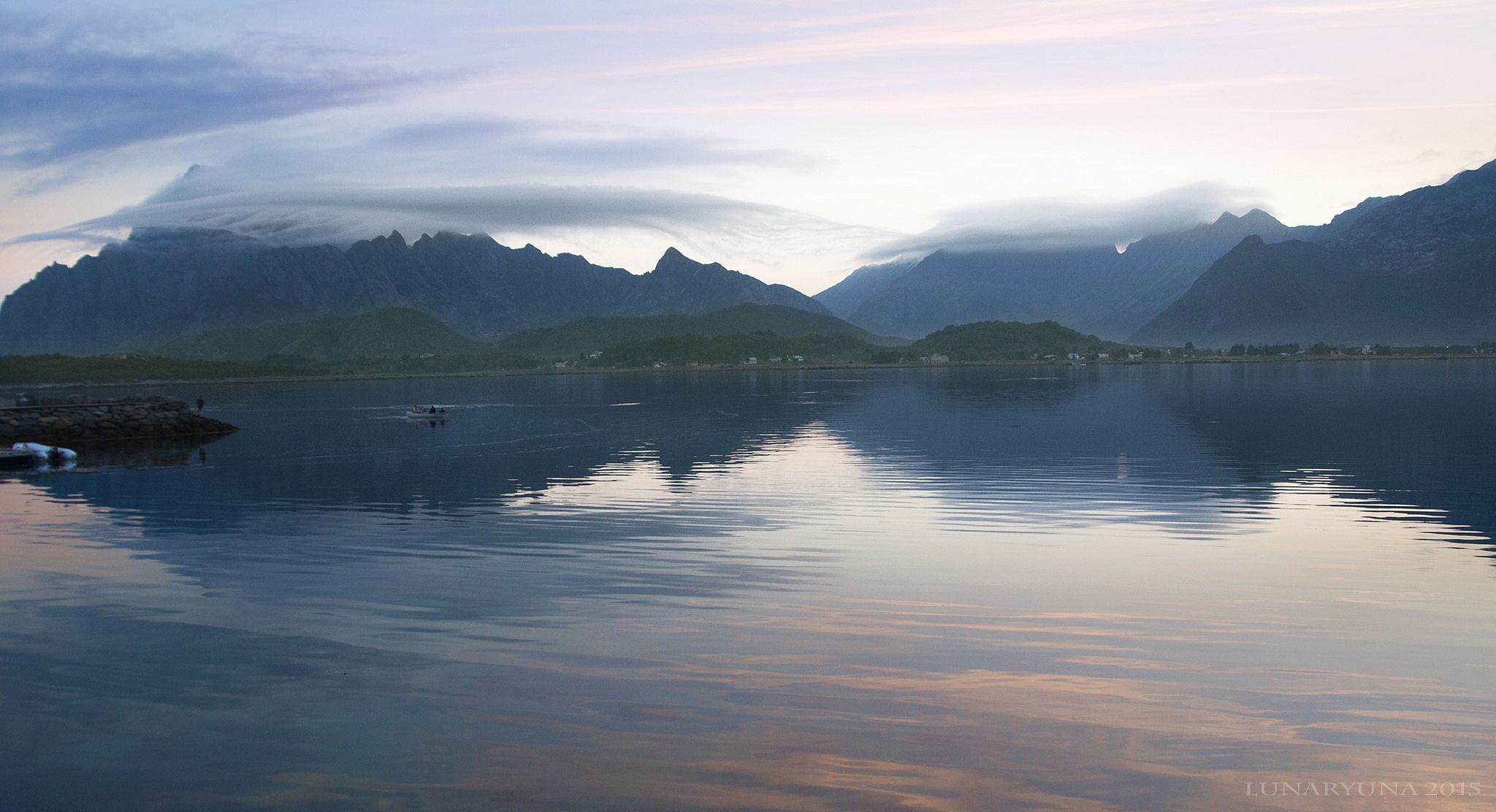 https://flic.kr/p/BeeKDL | an almost silent Northern sunset lullaby | a moody, sort of natural watercolour Lofoten sunset soft as a feather, turning these rugged islands into something soft and fairytale alike. To be out there on a boat at this magical hour is an experience to behold.