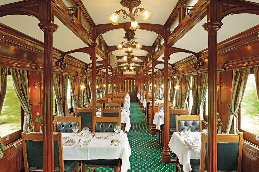 Period details abound on the Rovos coaches, including the carved-teak pillars of the dining car, whi... - Photo: Courtesy of Rovos Rail
