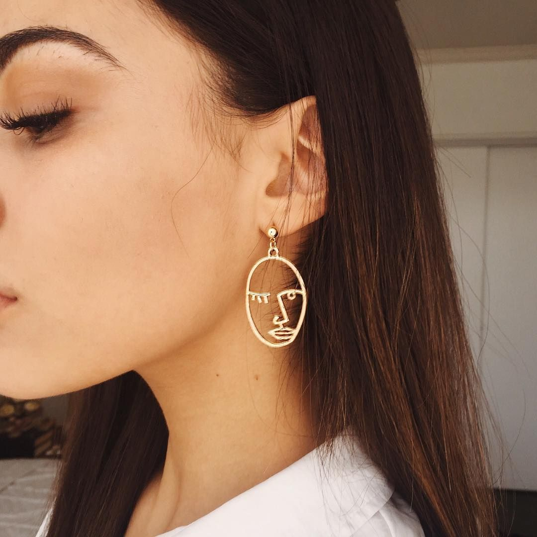 4a53a75be6f new earrings the abstract picasso winking face gold tone