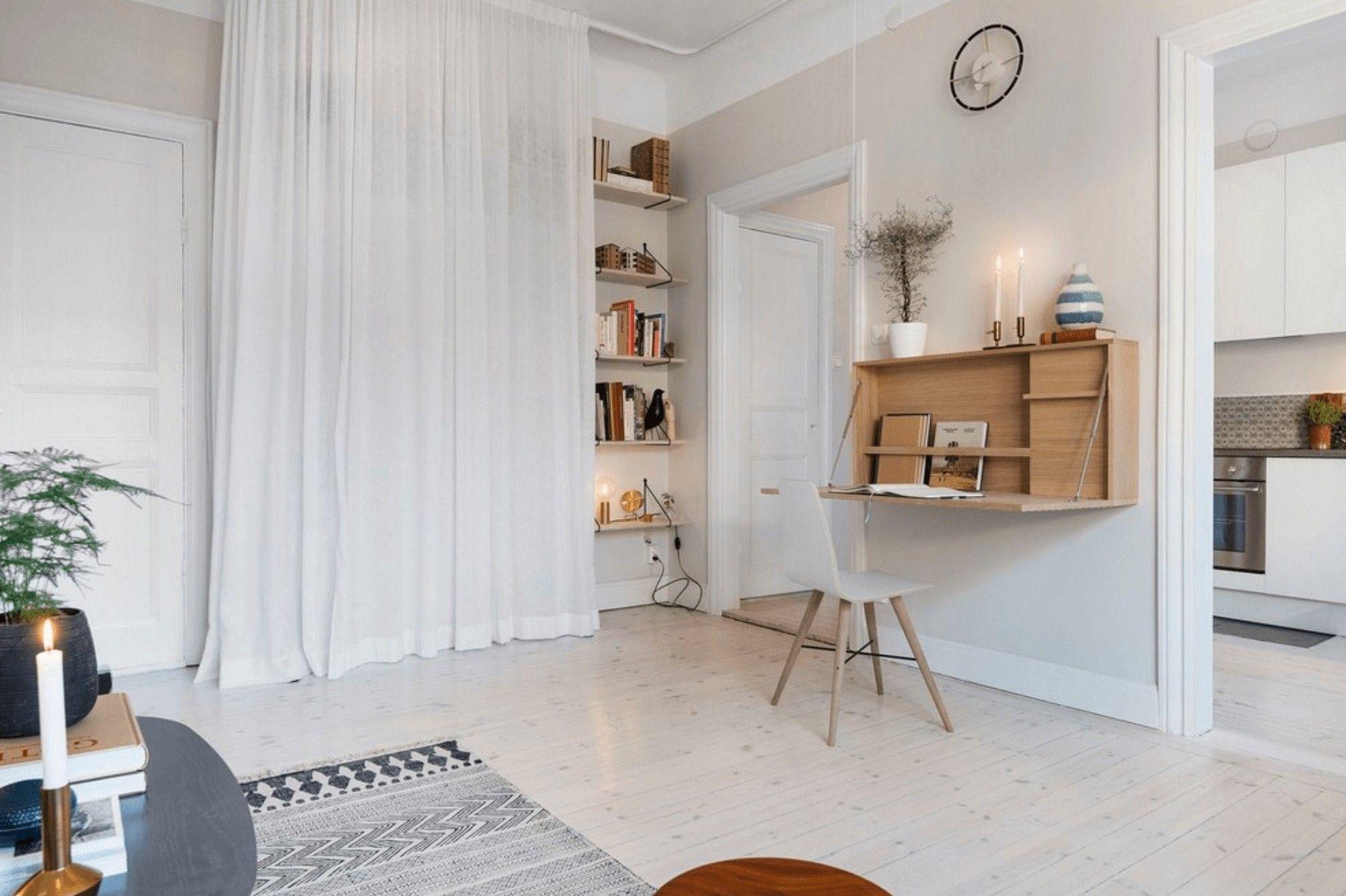 Curtain hiding a bookshelf Scandinavian interior design