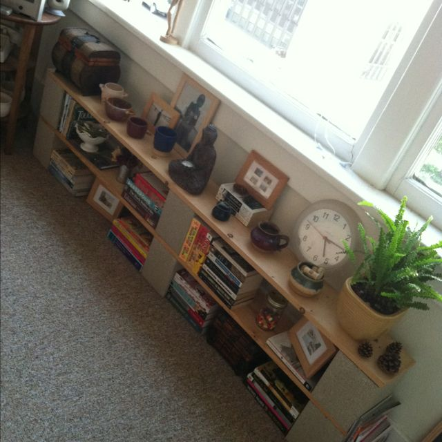 Book Shelve Made From Six Cinder Block And Two Plank Of Wood.