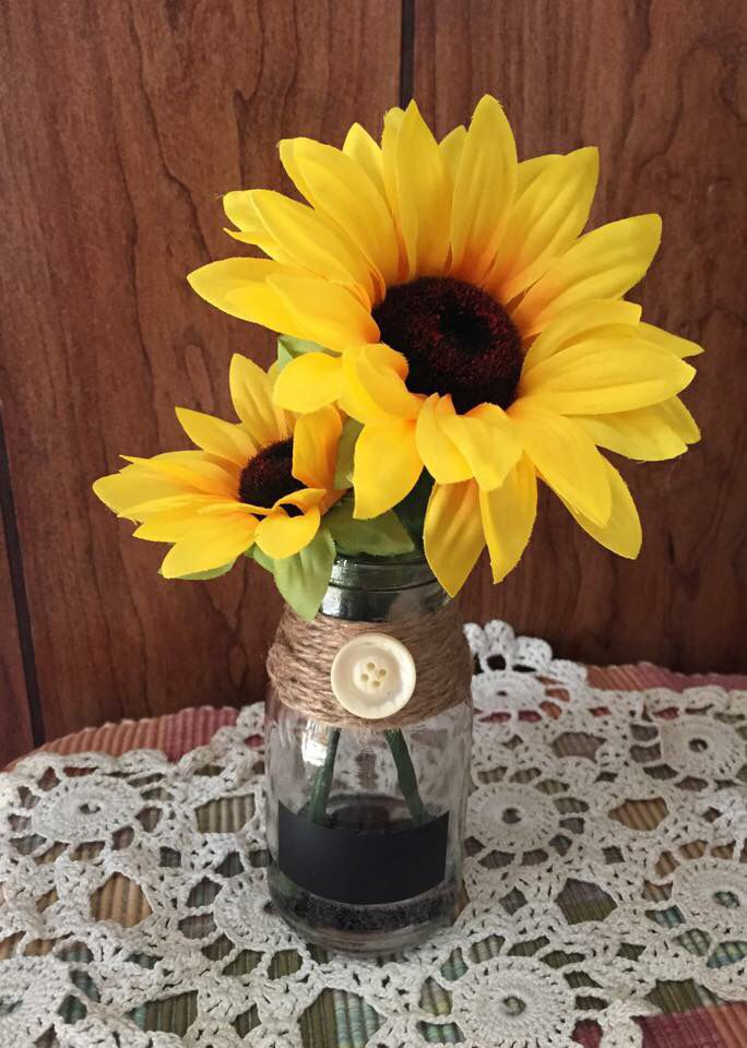 Made by me with glass milk bottle, sunflowers and acrylic water.