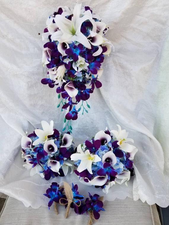 Cascading bridal bouquet, galaxy orchids, lilies, picasso calla lilies, blue hydrangea, teardrop bou #whitebridalbouquets
