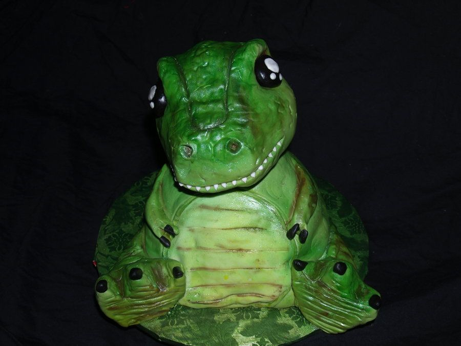 Baby trex cake covered in fondant with rice krispy treat