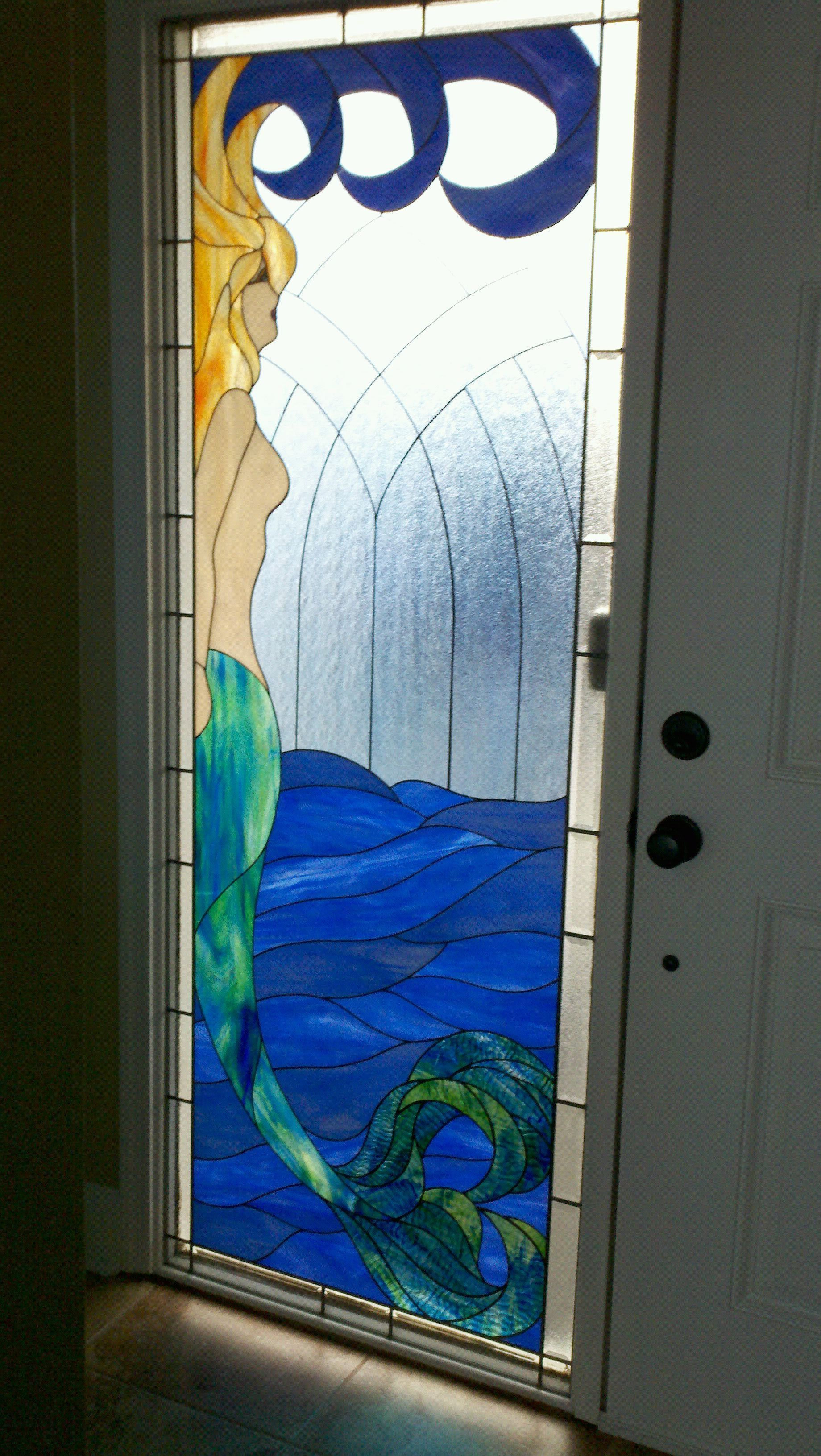 Mermaid Stained Glass by front door at the beach