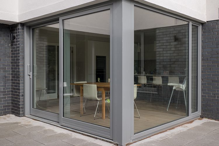 Contemporary Style Alu Clad Wood Lift And Slide Door Paired With A Large Fixed Window Contemporary Windows Sliding Doors Exterior Gray House Exterior