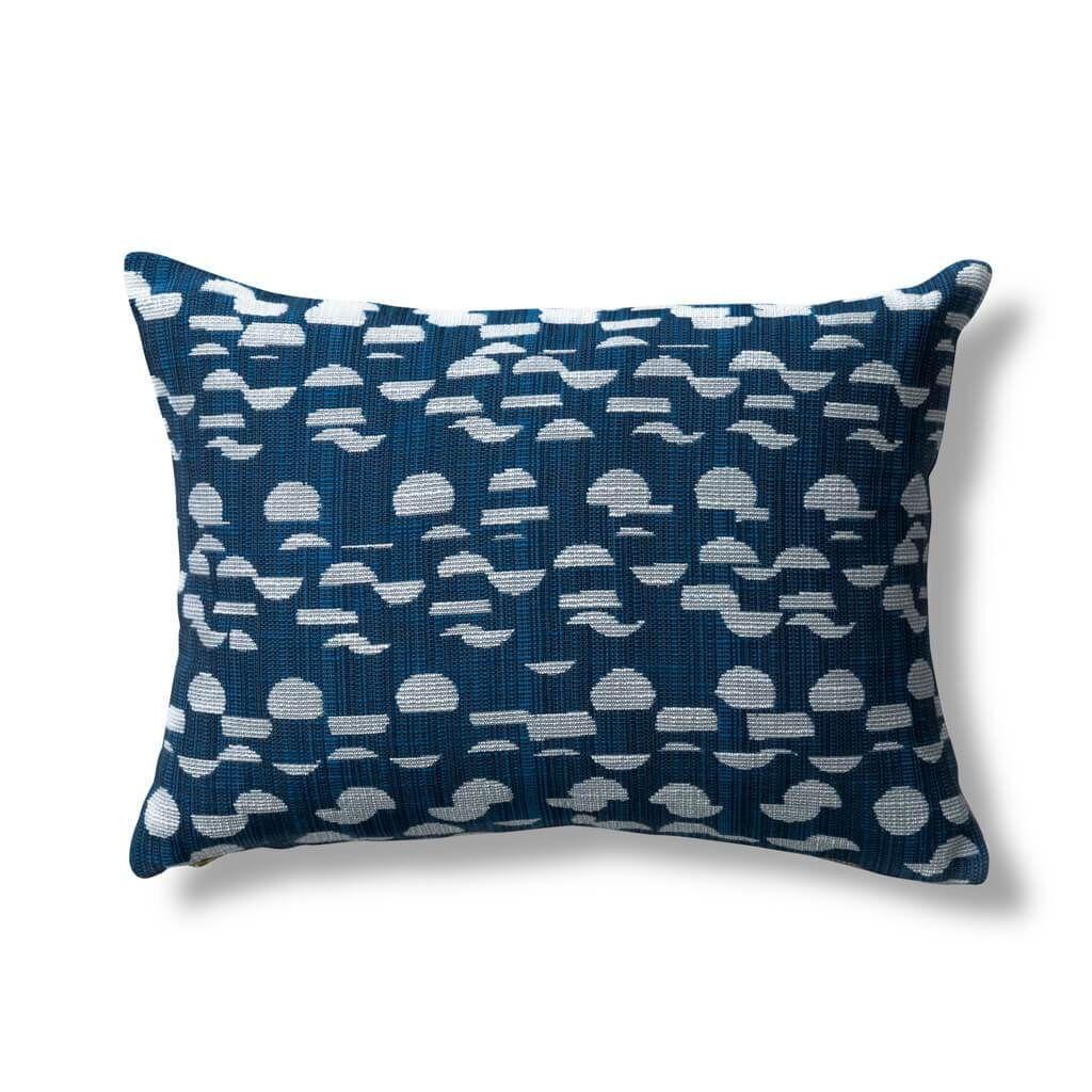 Cut up dot pillow in navy pillows